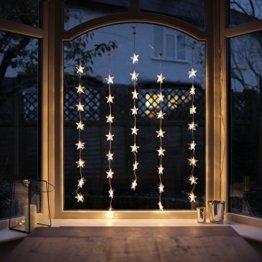 Lights4fun 40er LED Sternen Lichtervorhang perlweiß transparentes Kabel - 1