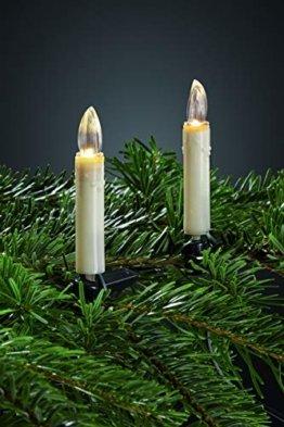 Hellum LED Christbaumbeleuchtung innen, 20x warmweiß LED Kerzen elfenbein mit Wachstropfen Schaft, Weihnachtsbaum Lichterkette mit grünem Kabel, Fassungsabstand 30 cm 560282 - 1