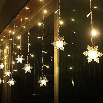 LED Lichterketten Vorhang, THOWALL 5.5*0.7M 93 LED Lichtervorhang mit 8 Modi & 16 Haken & 16 Große Schneeflocken für Schlafzimmer Hochzeit Geburtstag Garten Fenster Innen und Außen Deko, Warmes Gelb - 1