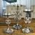 MichaelNoll 3er Set Kerzenständer Lilie Kerzenhalter Aluminium Silber Deko - Kerzenleuchter Modern für Stumpenkerzen - Tischdeko Hochzeit - Dekoration Wohnzimmer - H 23 cm / 28 cm / 32 cm - 3